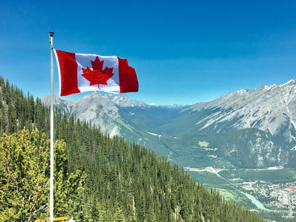 canada-flag-with-mountain-range-view-756790