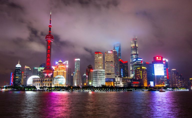 lighted-buildings-during-nighttime-near-body-of-water-2227942