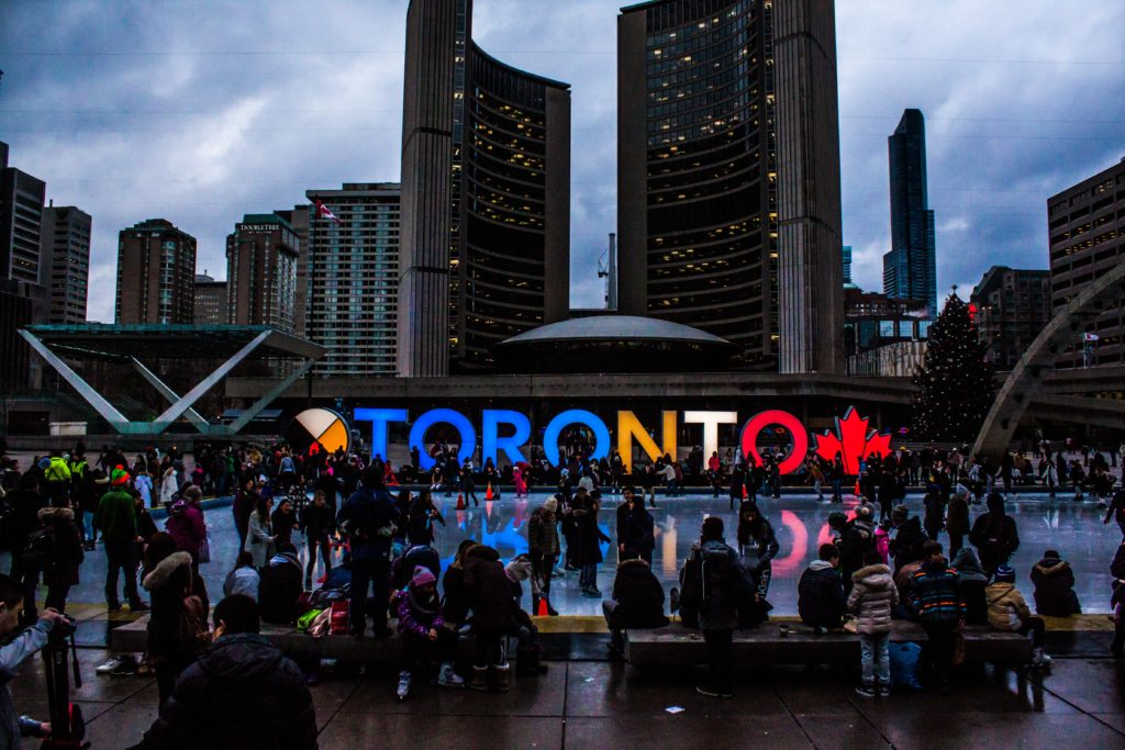 people-gathered-in-front-of-toronto-freestanding-signage-1750754