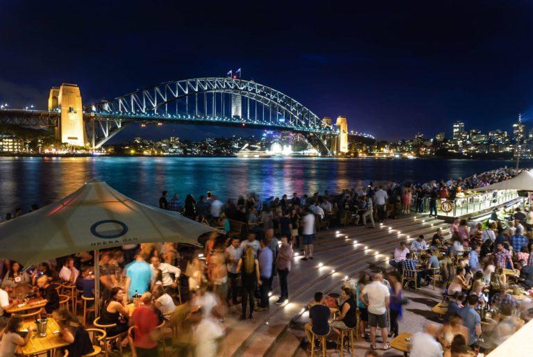people-sitting-and-standing-near-bridge-during-nighttime-762905