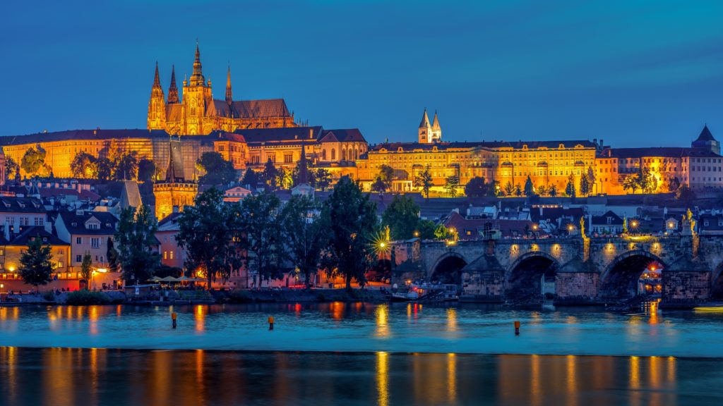 reflection-of-illuminated-lights-of-prague-castle-on-the-3046347